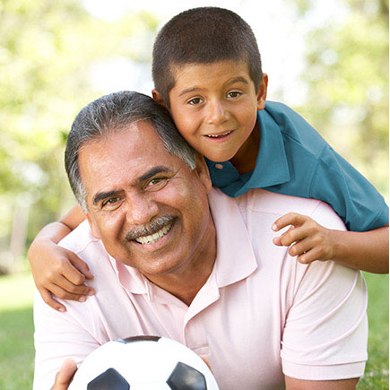 Grandfather and grandson with soccer ball