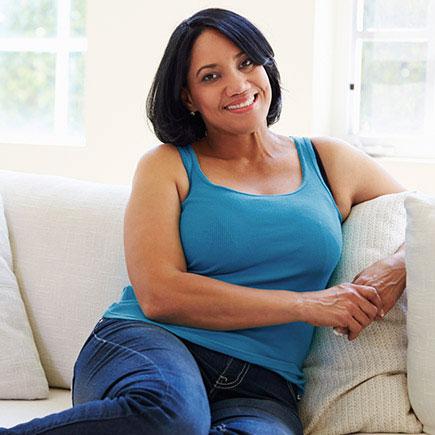 Woman in blue tank top on sofa